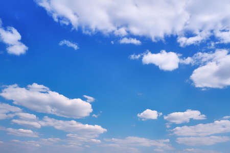 White Cumulus clouds in clear weather. The sky on a Sunny summer day. Background clouds on blue sky.
