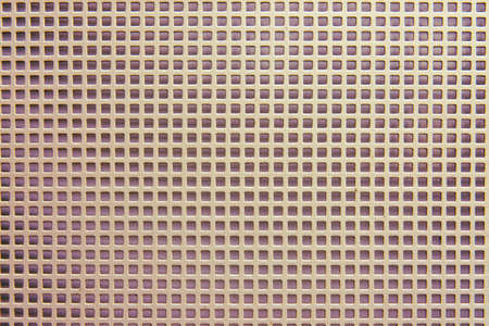 Background of metal barrage lattice from square sections, closeup