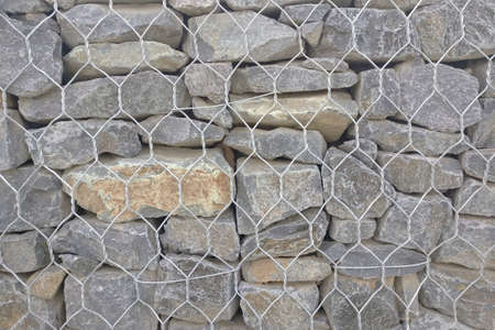 Background of reinforced stone wall with metal wire