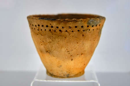An old clay vase from the Neolithic period. The oldest pottery in the world belongs to the Osipov culture. Discovered by archaeologists in the far East, Russia