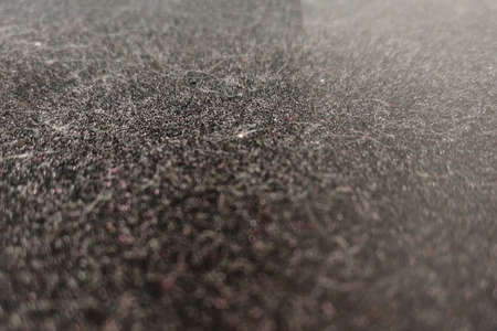 Texture of a dusty surface on a dark background, close-up Stockfoto