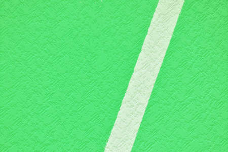 Light green painting on stone wall with rough surface texture, the background is separated by a line in half Standard-Bild - 157150573