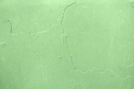 The texture of green peeling paint on a metal wall Archivio Fotografico