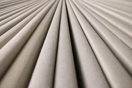 Background of round longitudinal parallel stripes, gray texture Imagens