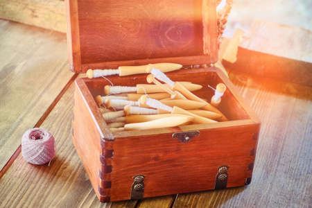 Box with spinning reels. Coil retro with coiled spindle for distaff Standard-Bild