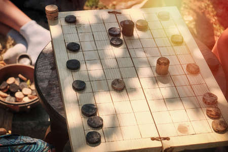 Table ancient Roman game similar to checkers - latrunculorum, latrunculi, or latro. Reconstruction of a plank of wood to play together.