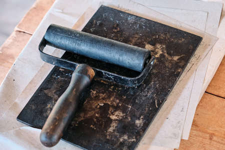 Roller for even distribution of ink during printing. Print books in the middle ages. Printing tools in the old days.
