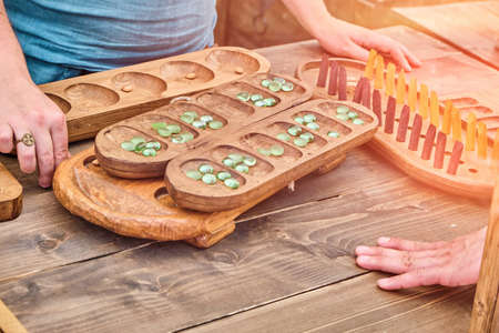 Ovare is a board logic game for two from vintage mancala games. Two players play the retro boardgame Kalah.