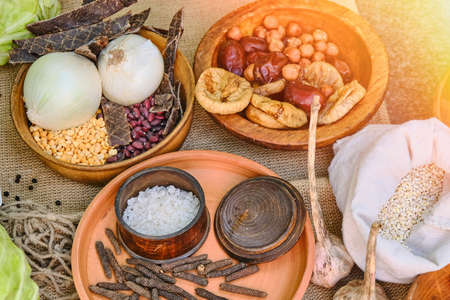 Food soldiers of the ancient Romans on the table, reconstruction. Salt, cereals, beans, dried fruits, garlic and cabbage. Food warriors on a hike in the Roman Empire.