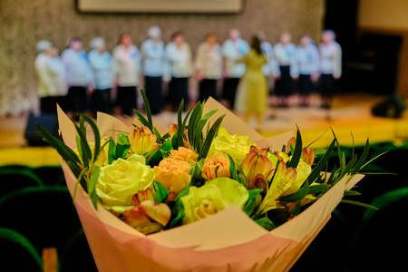 Bouquet of roses for singers and musicians. Roses for the singer of the song. Beautiful flowers for the participant of vocal competition.