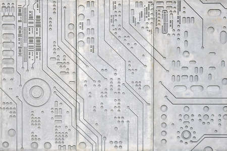 Concrete wall background with carved pattern of digital electronics circuit