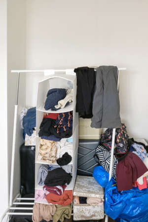 Clutter of things and clothes without a wardrobe