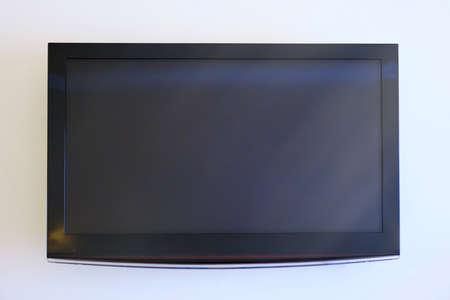 Black big television on white wall, mockup 스톡 콘텐츠 - 157637006
