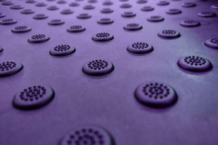 A dimpled background with raised round dots purple