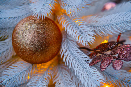 Winter Christmas tree with golden bauble and balls, close-up Stock Photo