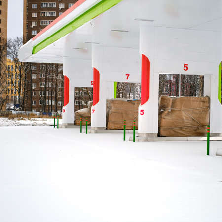 Closed refueling in snowy winter. Empty filling station on conservation