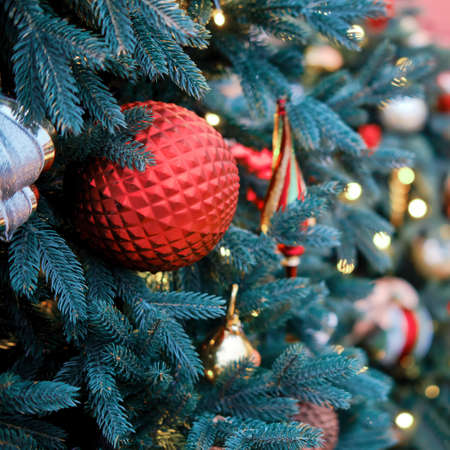 New year and xmas tree decorations with red ball, close-up