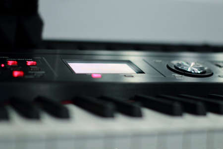 The synthesizer is in the recording Studio. Included electronic piano with burning scoreboard. Large white and black keys
