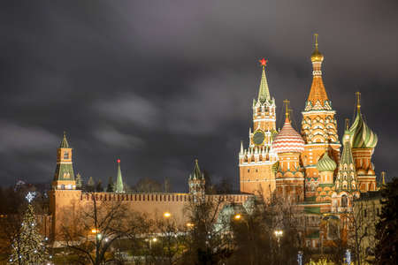 Spasskaya tower of the Kremlin and St. Basil's Cathedral in night - Moscow
