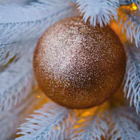 Golden rough ball hanging as decorations on a Christmas tree, close-up Stock Photo