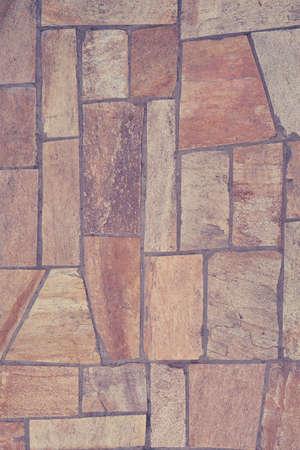 The texture of the floor is a beige tile irregular shape Foto de archivo