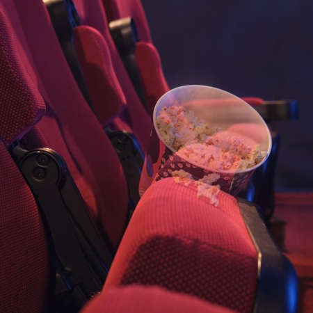 Abandoned popcorn on a chair in the cinema hall. Problems with bankruptcy of movie theaters and concert halls during the flu virus epidemic