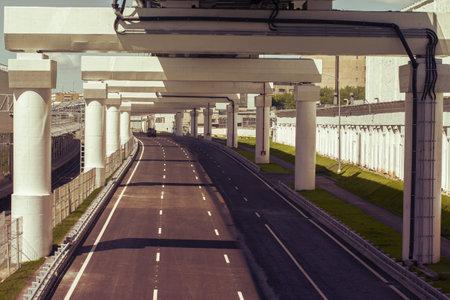 New empty road under the bridge overpass
