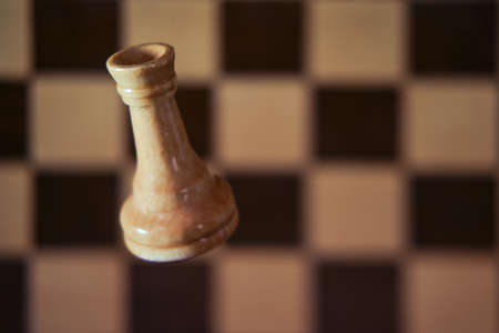 Chess white rook and chessboard, copy space background. Chess piece rook on the background of the cells of the chessboard
