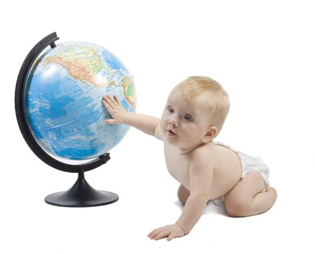 baby play: Little baby play with terrestrial globe and learn it, his hand is on pacific ocean . Isolated on white Stock Photo