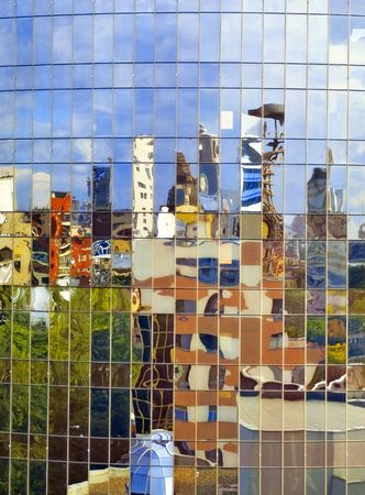 reverberate: Distorting surrealistic reflection of the city in the mirror wall of a building Stock Photo