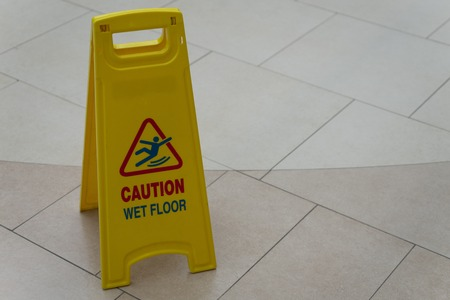 Sign showing warning of caution wet floor.