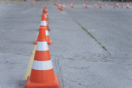 Traffic cones in driving school. Concept driving courses or driving licence training. Close up.
