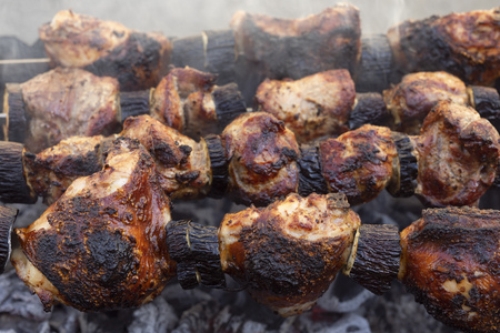 Shashlik of meat and vegetables cooked on a spit. Shish kebab