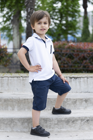 Stylish little boy in fashionable clothes. Children's fashion and style