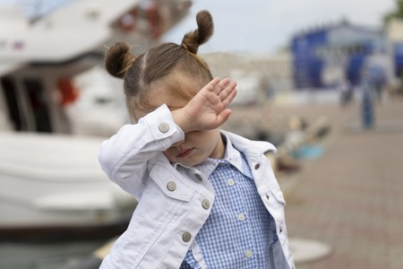 Little girl shows sign DAB in the marina 写真素材