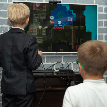SOCHI, RUSSIA-MAY 17, 2019: Two boys are play computer console in the club 写真素材