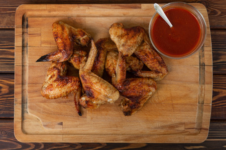 Hot and Spicy Chicken Wings with red sauce