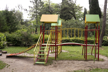 Iron multi colored playground on in the park. In harmony with nature eco-Playground for children