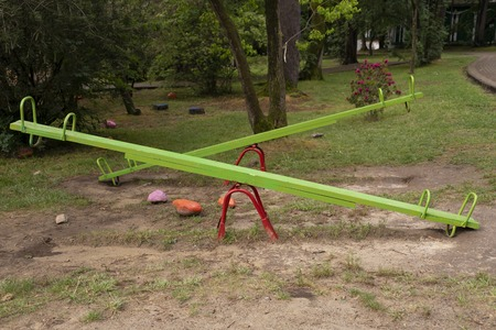 Seesaw or teeter-totter in playground. Recreation and entertainment for children. Fun for the whole family