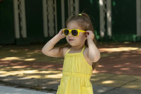 Fabulous kid is posing as fashion model. A little photomodeler