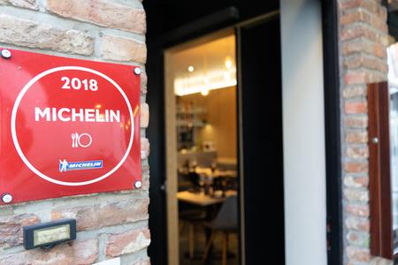 BRUGGE, BELGIUM - APRIL 20, 2019: A logo of Michelin Guides in a restaurant in Brugge city