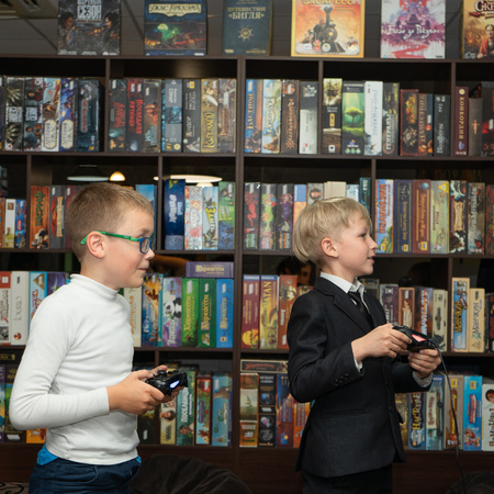 SOCHI, RUSSIA-MAY 17, 2019: Two boys are play computer games in the club for board games 報道画像
