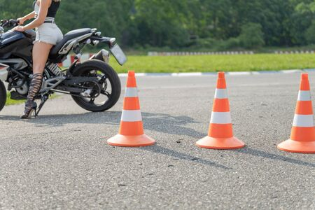 Focus on a traffic cone in driving school. Moto track. Close up