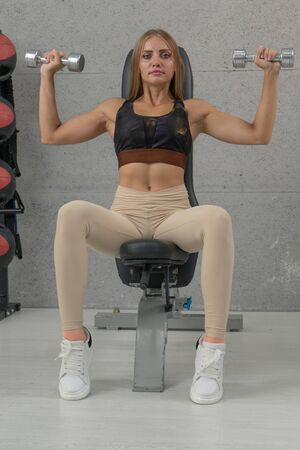 Caucasian woman in the gym, Young woman workout in fitness for her healthy lifestyle. Imagens