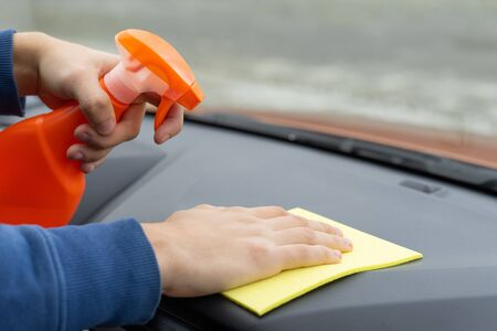 Hand cleaning dashboard with microfiber cloth. Car care concept. Car wash