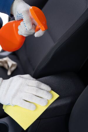 Chemical cleaning of car armrest. Detergents for cleaning of salon of the vehicle. Car care concept. Car wash. Care about auto interior.