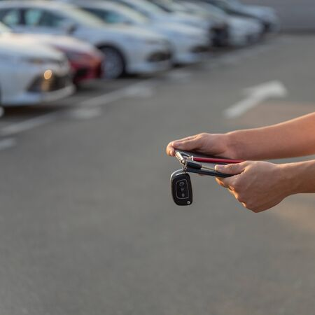 Car keys in the hands of a car dealer. Selective focus on a key from vehicles