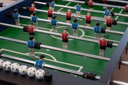 Concept of Board games. Table football game, Soccer table with red and blue players Reklamní fotografie
