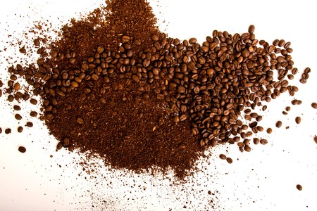 milled: coffee beans and milled coffee background