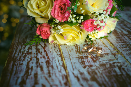life partners: bridal bouquet and newlyweds rings. Stock Photo
